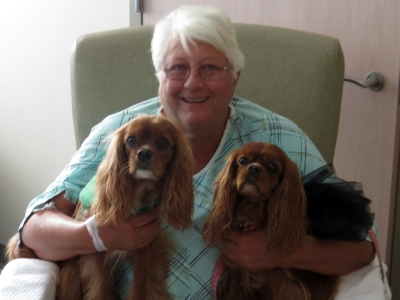Pet assist therapy dogs, Ozzie and Maiya with a happy patient before being discharged.